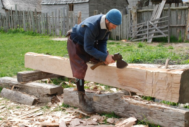 The fire gave volunteers an opportunity to practice their 17th Century building skills - Seeing plumb while hewing flat